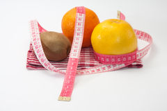 Grapefruit, orange and kiwi with tape measure Royalty Free Stock Photo