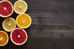 Grapefruit orange and sweety halves on left side. Variety of citrus fruits healthy diet sporty lifestyle stock image