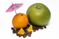 Grapefruit and orange with umbrella Royalty Free Stock Image