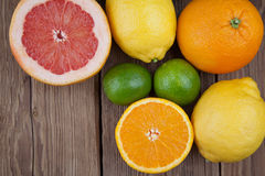 Grapefruit with other fruits on wood Stock Image