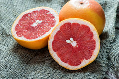 Grapefruit over rustic background Royalty Free Stock Images