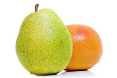 Grapefruit and pear. Royalty Free Stock Photo