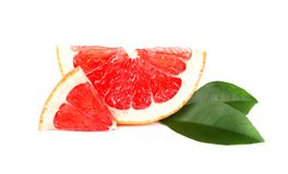 Grapefruit piece isolated on white background. Fresh fruit. With clipping path. Fresh grapefruit with green leaves Stock Photo