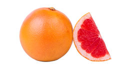 Grapefruit a piece. A grapefruit a piece on a white background Stock Photo