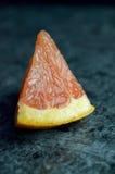 Grapefruit pieces Stock Photos