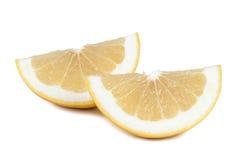 Grapefruit pieces on white background Royalty Free Stock Image