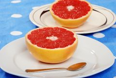 Grapefruit on a plate Royalty Free Stock Image
