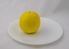A Grapefruit on a Plate Stock Photo