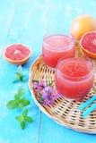 Grapefruit pulp juice and grapefruit halves Stock Photo