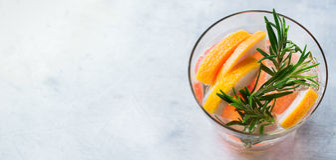 Grapefruit rosemary fresh infused water detox drink cocktail lemonade Stock Photos