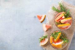 Grapefruit rosemary fresh infused water detox drink cocktail lemonade Stock Photo