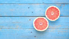 Grapefruit, on rustic table Royalty Free Stock Photos