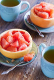 Grapefruit salad. With cinnamon and brown sugar in hollowed-out grapefruits, selective focus Royalty Free Stock Photo