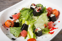 Grapefruit salad with iceberg lettuce and rolls Stock Image