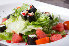 Grapefruit salad with iceberg lettuce and rolls Royalty Free Stock Photos
