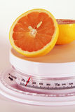 Grapefruit on a scale Stock Photography