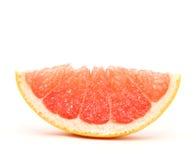 Grapefruit segment. Closeup on white background, isolated royalty free stock images