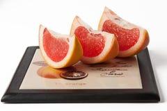 Grapefruit segments. On white. Large plan Royalty Free Stock Photography