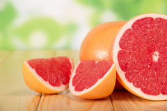 Grapefruit segments on a wooden table Royalty Free Stock Images
