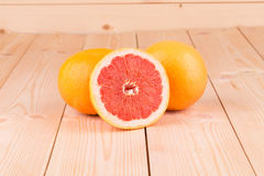 Grapefruit segments on a wooden table Stock Image