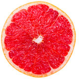 Grapefruit slice. Cross-section of a red grapefruit isolated on white background Royalty Free Stock Photo