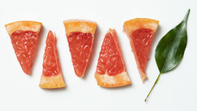 Grapefruit with slice detail Royalty Free Stock Photo
