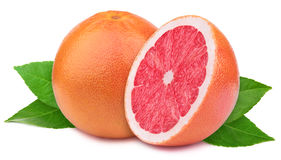Grapefruit with slice  on white Royalty Free Stock Images