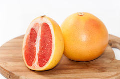 Grapefruit slice on the wooden board Stock Image