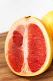 Grapefruit slice on the wooden board Royalty Free Stock Photography