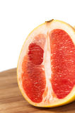 Grapefruit slice on the wooden board Stock Images