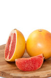 Grapefruit slice on the wooden board Royalty Free Stock Image