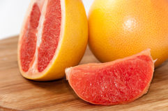 Grapefruit slice on the wooden board Stock Photography
