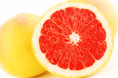 Grapefruit. Sliced on the table Stock Photography