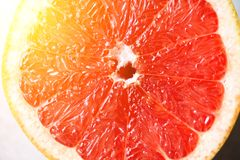 Grapefruit sliced half on grey background. Citrus fruit macro. Copy space, top view. Summer food concept.  stock images