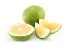 Grapefruit slices. Green grapefruits, half of grapefruit and grapefruit slices Royalty Free Stock Photos