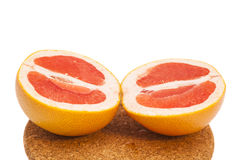 Grapefruit slices on breadboard Stock Image