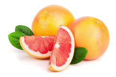 Grapefruit and slices with leaves isolated on white background royalty free stock photo