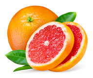 Grapefruit with slices and leaves on white Royalty Free Stock Image
