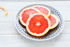 Grapefruit slices on a plate Royalty Free Stock Photo