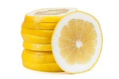 Grapefruit slices on white background Stock Photos