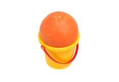 Grapefruit in a plastic bucket. Grapefruit in a small yellow plastic bucket Stock Photography