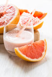 Grapefruit smoothie and fresh grapefruit Stock Image