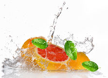 Grapefruit with splashing water Stock Photos