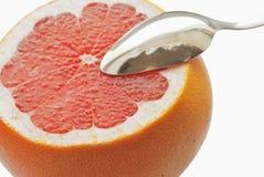 Grapefruit&spoon Stock Image