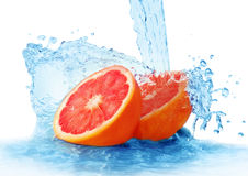 Grapefruit in a spray of water Royalty Free Stock Photo
