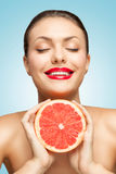 Grapefruit squeeze. Royalty Free Stock Photo