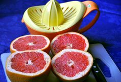 Grapefruit and squeezer Stock Photos
