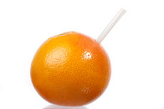 Grapefruit with straw stock images