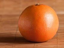 Grapefruit on straw mat Royalty Free Stock Image
