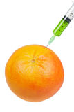 Grapefruit with syringe inserted Royalty Free Stock Photos